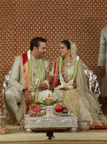 Newlyweds Isha Ambani and Anand Piramal pose for a photograph, in Mumbai, Wednesday. PTI photo