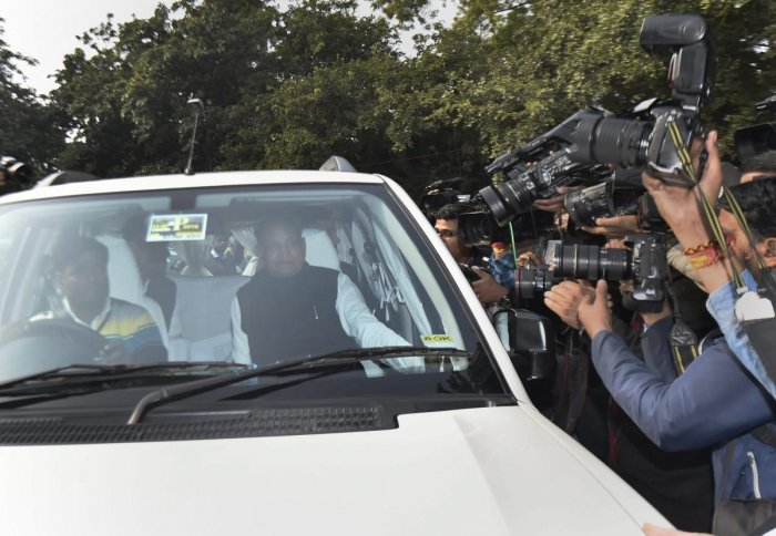 Congress senior leader Ashok Gehlot leaves after a meeting with Congress President Rahul Gandhi at his residence, in New Delhi on Thursday. PTI photo