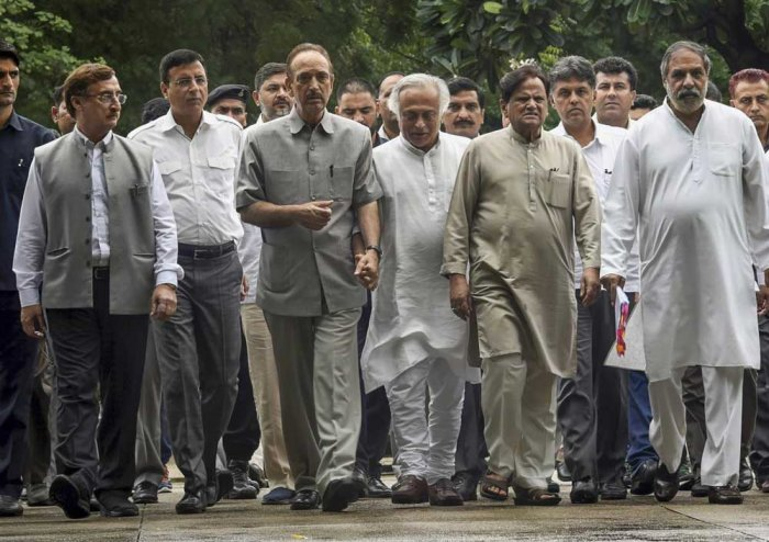 Senior Congress leaders (L-R) Vivek Tankha, Randeep Surjewala, Ghulam Nabi Azad, Jairam Ramesh, Ahmed Patel, Anand Sharma and others leave after a meeting with CVC, K V Chowdary at Central Vigilance Commission, in New Delhi. PTI Photo