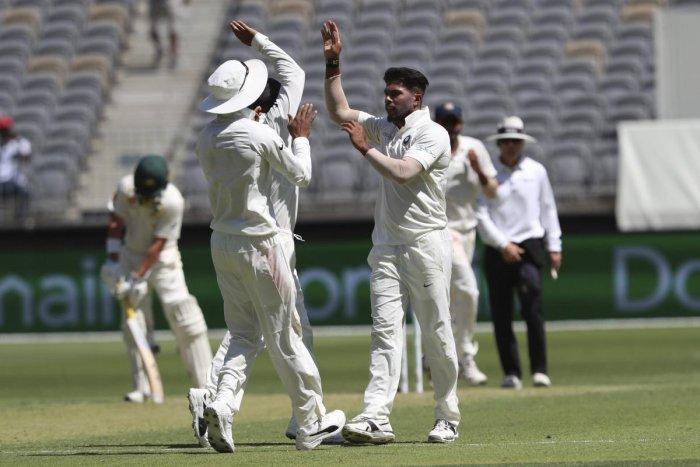 India's Umesh Yadav, right, celebrates taking the wicket of Australia's Usman Khawaja during the second cricket test in Perth, Australia, Friday, Dec. 14, 2018. AP/PTI
