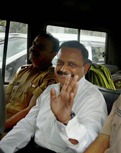 File picture of Lt Col Prasad Purohit being taken to Session Court from Taloja Jail in Mumbai on Tuesday. PTI