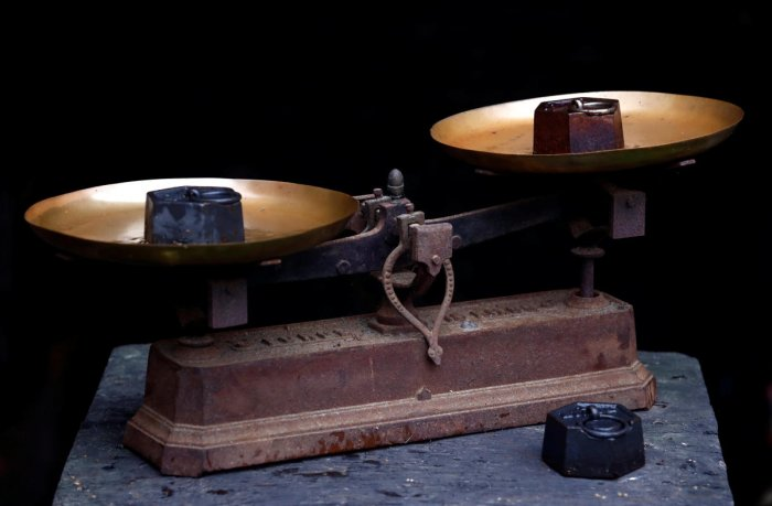 Two one kilogram weights are seen on a vintage scale in Saussay-la-Campagne. Reuters photo