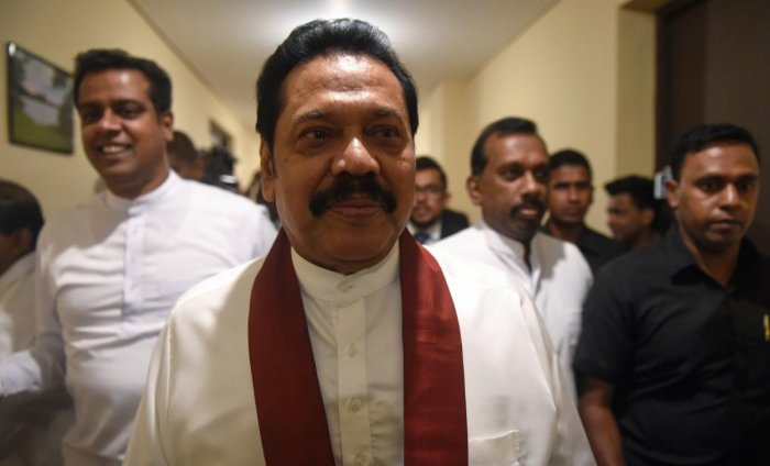 Sri Lanka's strongman leader Mahinda Rajapakse will step down from his disputed position of premier, his son said Friday, signalling an end to a crippling seven-week long power struggle. AFP file photo