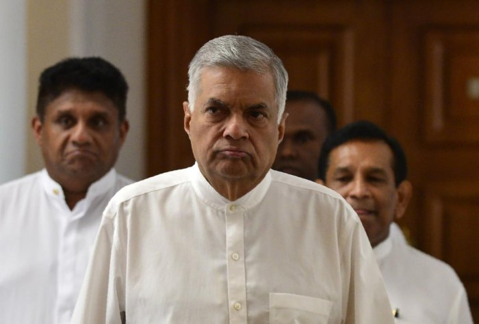 Sri Lanka's ousted prime minister Ranil Wickremesinghe (C) arrives for a press conference in Colombo. AFP Photo