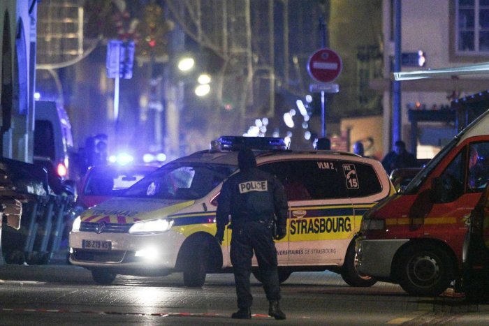 Policemen and emergency medical response vehicules are seen in the rue des Grandes Arcades in Strasbourg, eastern France, after a shooting breakout. AFP photo