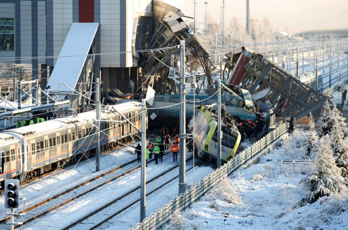 Rescue workers search at the wreckage after a high speed train crash in Ankara, Turkey. REUTERS Photo