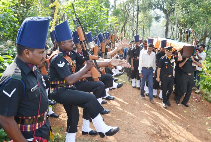 Mortal remains of Lt General (Retd) B C Nanda being carried by military officials to its place of burial in Madikeri, on Thursday.