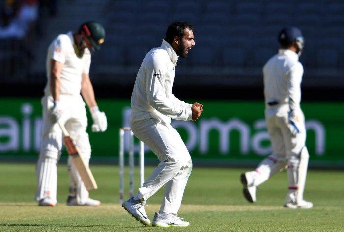 SURPRISE WEAPON India's Hanuma Vihari (centre) celebrates the dismissal of Australia's batsman Shaun Marsh on Friday. AFP