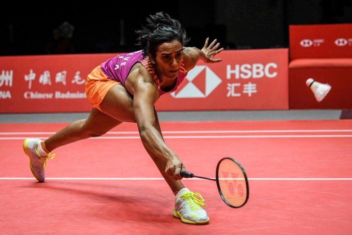 ATHLETIC: India's PV Sindhu returns to Zhang Beiwen of the US during their Group A women's singles game in Guangzhou on Friday. AFP