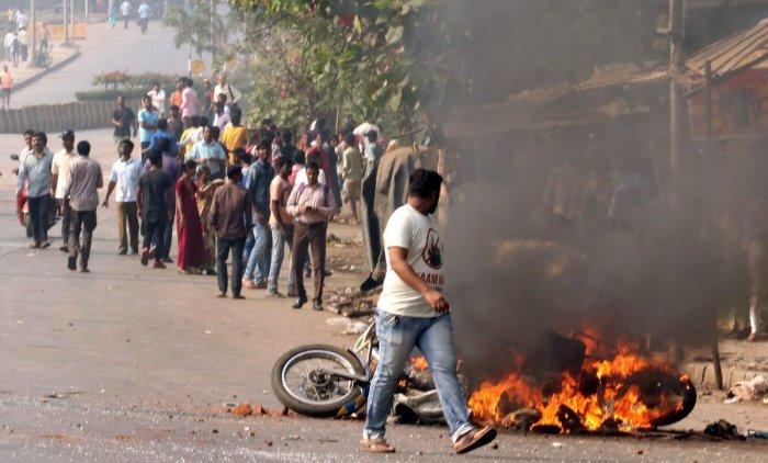 Protesters burn a bike at Vikroli in Mumbai during a protest over Bhima Koregaon violence. PTI file photo