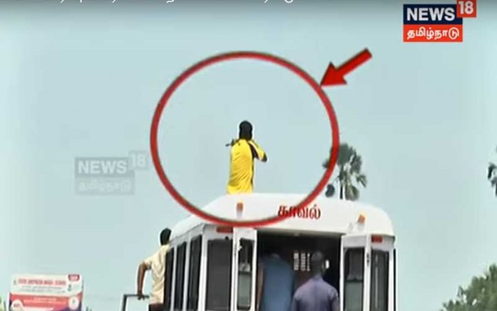 The visuals show the policemen climbing atop the vehicle of the Thoothukudi District Police and aiming at the protesters. Image: TV grab New18 Tamil Nadu