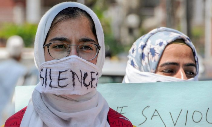 Students cover their faces during a protest seeking justice for 8-year-old Kathua girl who was allegedly raped and murdered, in Srinagar. PTI Photo
