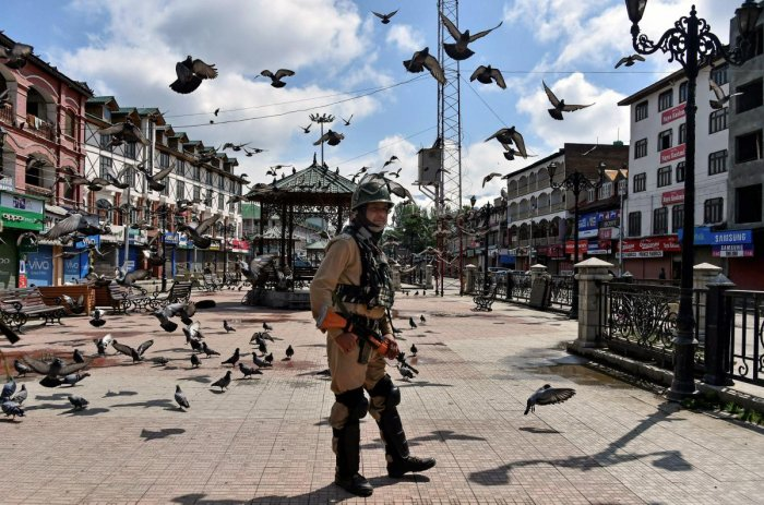 A security person stands guard during restrictions and strike called by separatists against Prime Minister Narendra Modi's visit to the state. PTI file photo.