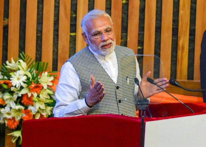 Prime Minister Narendra Modi addresses after inaugurating Kishanganga Power Station (330 MW) Bandipora, during a function at SKICC in Srinagar, on Saturday. PTI