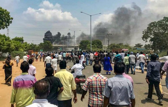 Smoke billows out of burning vehicles after a violent protest demanding closure of Vedanta's Sterlite Copper unit entered the 100th day, in Tuticorin, on Tuesday. The police opened fire in which at least one man was killed. (PTI Photo)