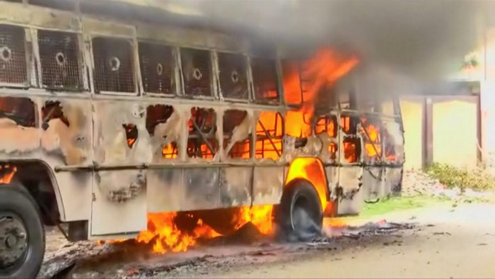 A bus on fire is seen during a protest against the construction of a copper smelter by Vedanta Resources, in Thoothukudi, Tamil Nadu, on Wednesday. ANI via REUTERS