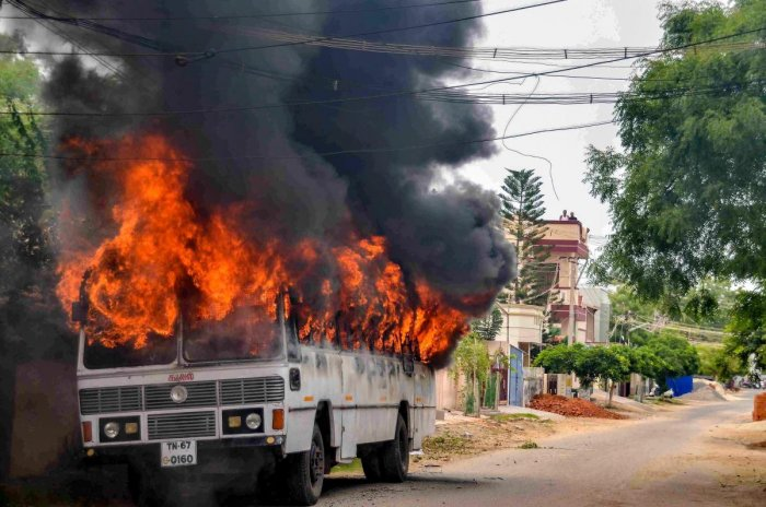 Tuticorin: Smoke billows from a buring bus during protests demanding the closure of Vedanta's Sterlite Copper unit, in Tuticorin, on Wednesday. In fresh violence today, one person was killed during the clash, after police's open fire killing at least ten