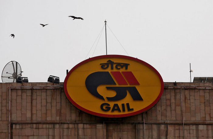 FILE PHOTO: Birds fly past the logo of India's state-owned natural gas utility GAIL (India) Ltd installed on its corporate office building in New Delhi, India, April 26, 2018. REUTERS/Adnan Abidi/File photo