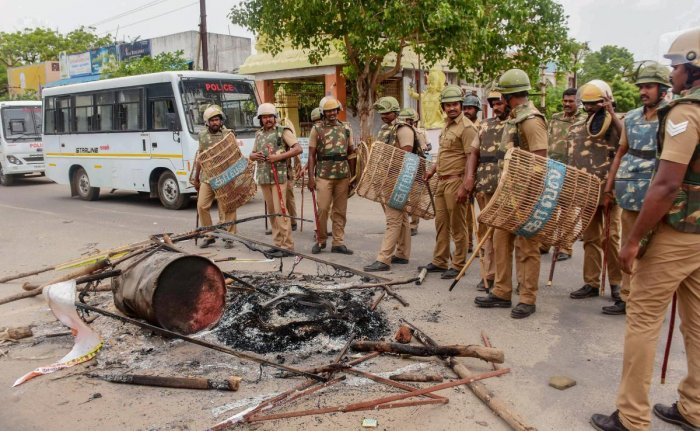 Police personnel deployed after violent protests demanding the closure of Vedanta's Sterlite Copper unit, in Tuticorin, on Thursday. Over 100 people were arrested for protesting police firing on Tuesday and Wednesday in the port city that left 13 dead. (P