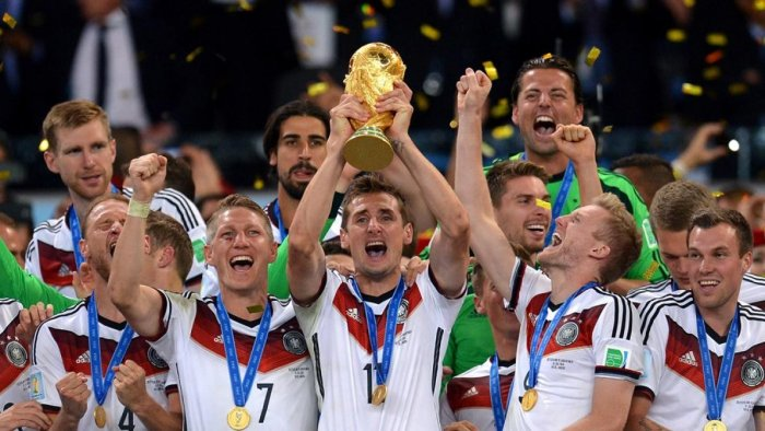 Germany celebrate with the World Cup trophy after beating Argentina in 2014 final.