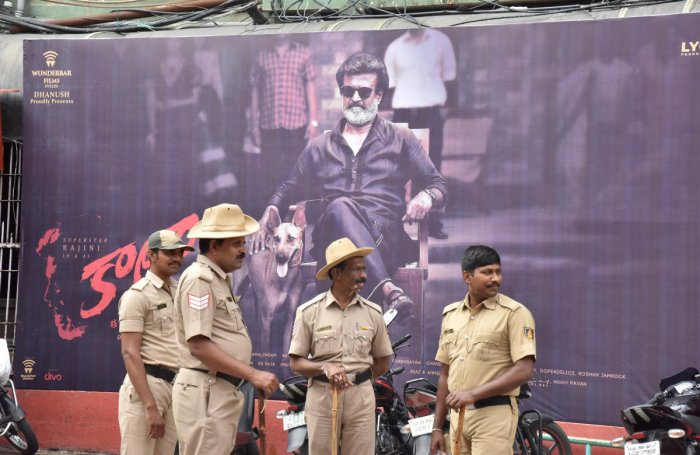 Police personnel stand guard outside the Rex Theatre, Brigade Road, where Kaala was released on Thursday. DH Photo/B K Janardhan