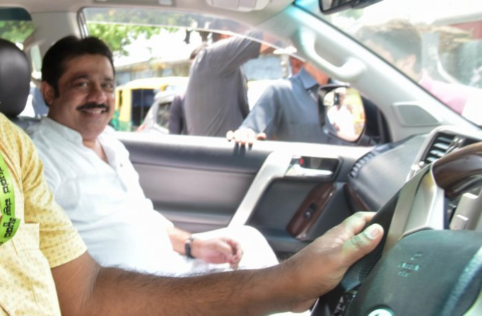 In this file photo, Zameer Ahmed Khan arrives in his high-end car to file papers as a Congress nominee for the Chamarajpet seat.
