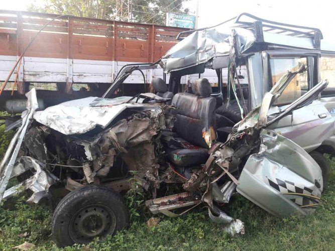 The mangled remains of the MUV which crashed into a stationary lorry on National Highway 4 near Hiriyur in Chitradurga district in the early hours of Wednesday.