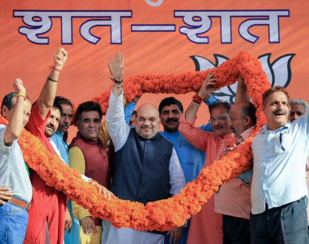 BJP president Amit Shah being garlanded by party leaders during a public rally on the death anniversary of party founder Syama Prasad Mukherjee, in Jammu on Saturday. PTI