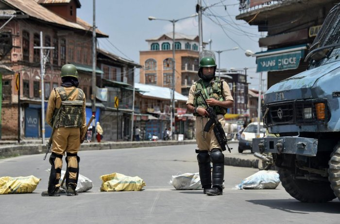 CRPF personnel stand guard during restrictions at Downtown Nowhatta, in Srinagar on Friday. (PTI Photo)