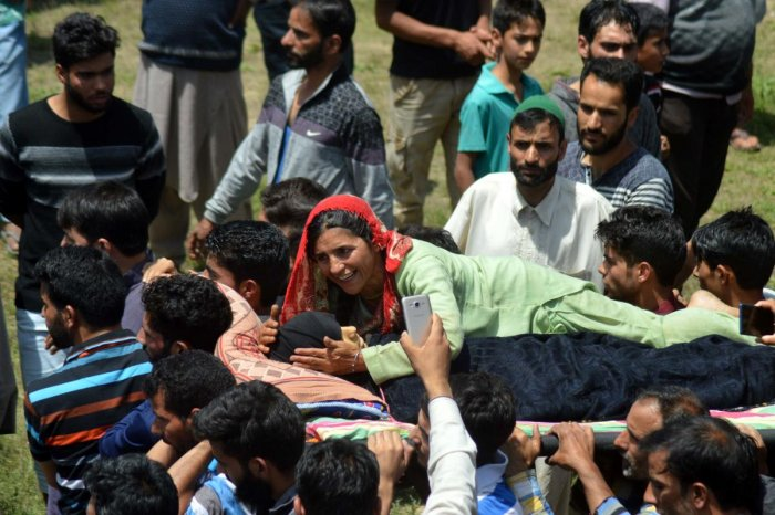 A woman wails during the funeral of 12-year-old Andleeb Ali, who was killed in army firing on July 7, in Hawoora near Kulgam in Kashmir.