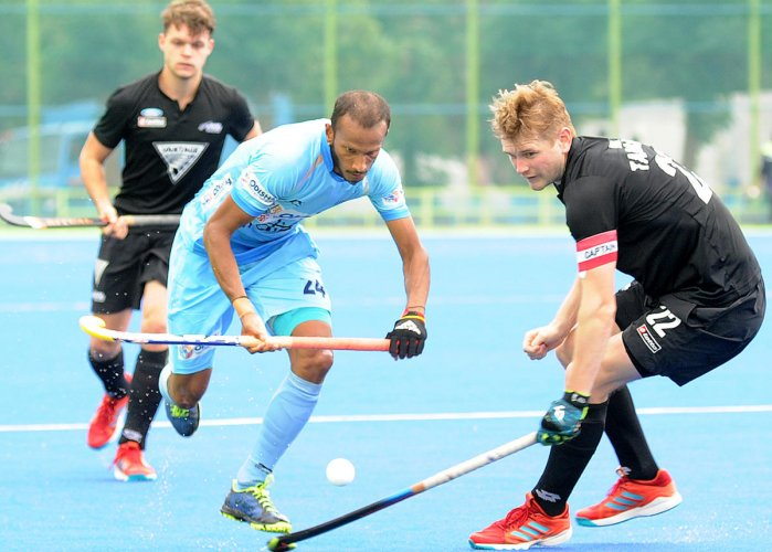 FINE DASH: India's S V Sunil (left) attempts to get past Tarrant Blair of New Zealand in the opening 'Test' match on Thursday. DH Photo/ Srikanta Sharma R