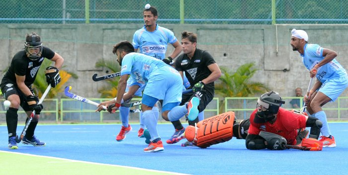 FINE EFFORT India's Manpreet Singh (second from right) attempts to score during the second 'Test' match against New Zealand on Saturday. DH PHOTO/ Srikanta Sharma R