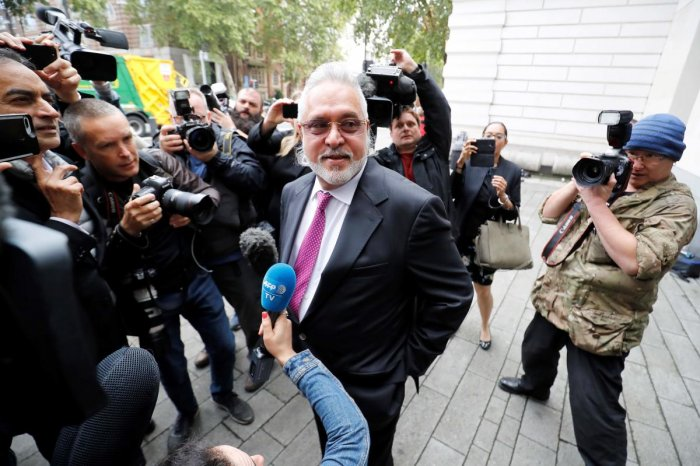 Tycoon Vijay Mallya speaks to the media as he arrives to appear at Westminster Magistrates Court in central London. AFP