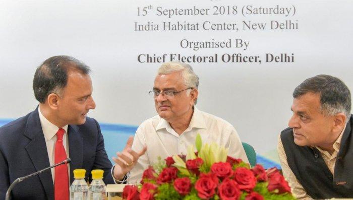 Chief Election Commissioner O P Rawat, Election Commissioner Ashok Lavasa (R) and Chief Electoral Officer Delhi Vijay Dev (L) during a symposium on 'International Day of Democracy' in New Delhi on Saturday. PTI