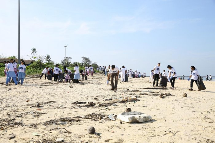 Volunteers take part in a coastal cleanup as a part of the International Coastal Cleanup organised by the Coast Guard in Mangaluru on Saturday.