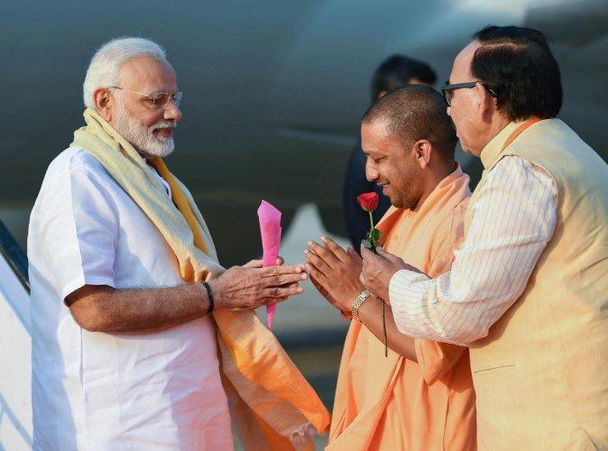 Prime Minister Narendra Modi being welcomed by the Chief Minister of Uttar Pradesh Yogi Adityanath, on his arrival in Varanasi, Uttar Pradesh, September 17, 2018. (PIB Photo via PTI)