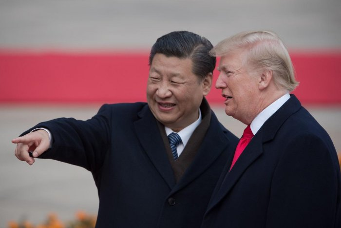 Chinese President Xi Jinping and US President Donald Trump attend a welcome ceremony at the Great Hall of the People in Beijing on November 9, 2017. Trump on September 18, 2018 accused China of seeking to influence upcoming US elections by taking aim at h