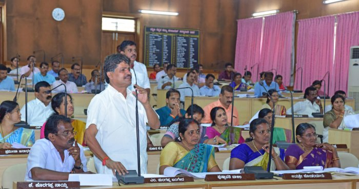 A member raises a point in the Zilla Panchayat meeting in Mangaluru on Saturday.