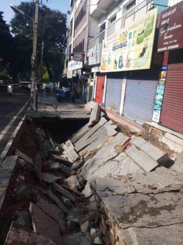 The pavement that caved in at Navrang, near Rajajinagar, following the heavy rain on Tuesday.