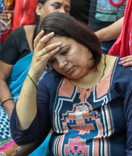 Kalpana, wife of Vivek Tiwari, who was shot by a police constable on patrol duty, mourns his death, in Lucknow on Saturday. PTI