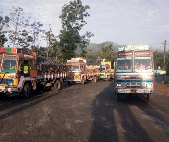 Lorries intercepted by villagers at Vanaguru junction on Bisle-Kukke-Subramanya Road, in Hassan taluk, recently.