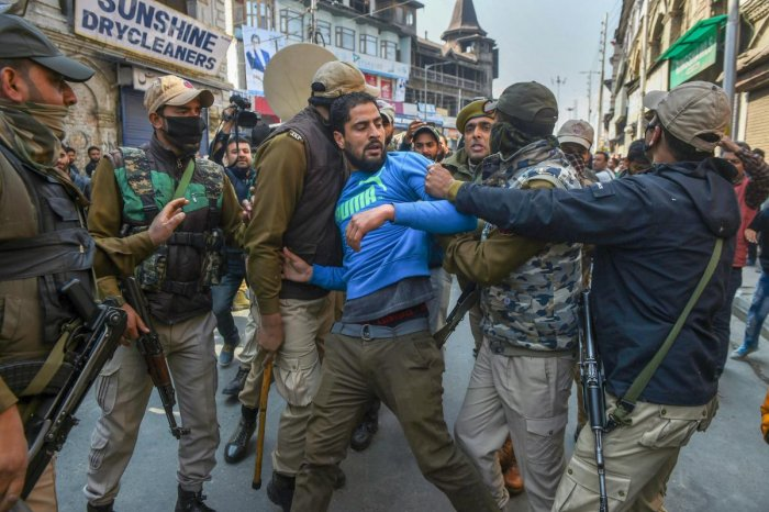 Police take away supporters of senior separatist leader Mohammad Yasin Malik during a protest march over the death of 7 civilians in a blast at an encounter site in Laroo area of Kulgam district of south Kashmir, at Kokar Bazar in Srinagar on Tuesday. PTI