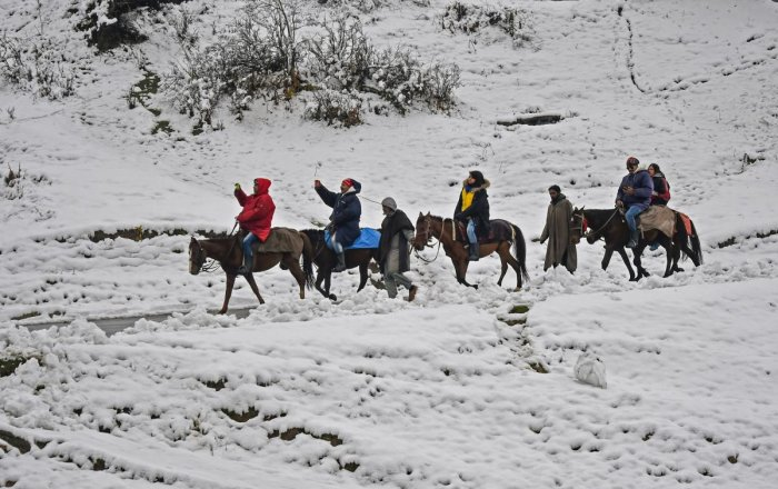 Gulmarg: Tourists enjoy horse ride after seasons first snow fall at famous ski resort of Gulmarg, in Distrct Baramulla of North Kashmir, Friday, November 2, 2018.( PTI Photo/S Irfan)(PTI11_2_2018_000140B)
