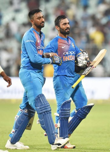 Krunal Pandya (left) and Dinesh Karthik saved India the blushes with an unbroken stand for the sixth wicket in the first T20I in Kolkata. PTI