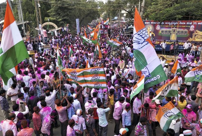 Congress party supporters celebrate party candidate Anand Siddu Nyamagouda's victory in the Jamkhandi Assembly bypoll in Jamkhandi. PTI