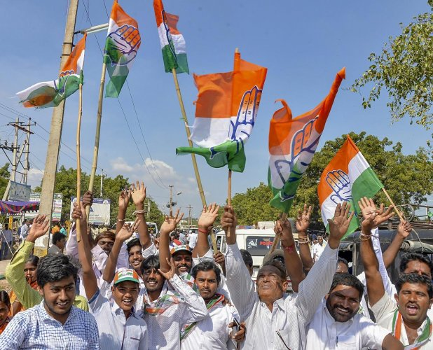 Congress supporters celebrate party candidate V S Ugrappa's win in the Bellary Loksabha by-poll election, in Bellary, Karnataka, on Tuesday. PTI