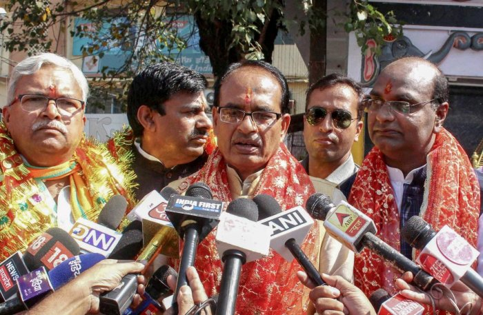 Madhya Pradesh Chief Minister Shivraj Singh Chouhan speaks to mediapersons after offering prayer with Bhopal BJP candidates before filing their nomination papers and launch of the election campaign for state Assembly elections, in Bhopalon Friday. PTI