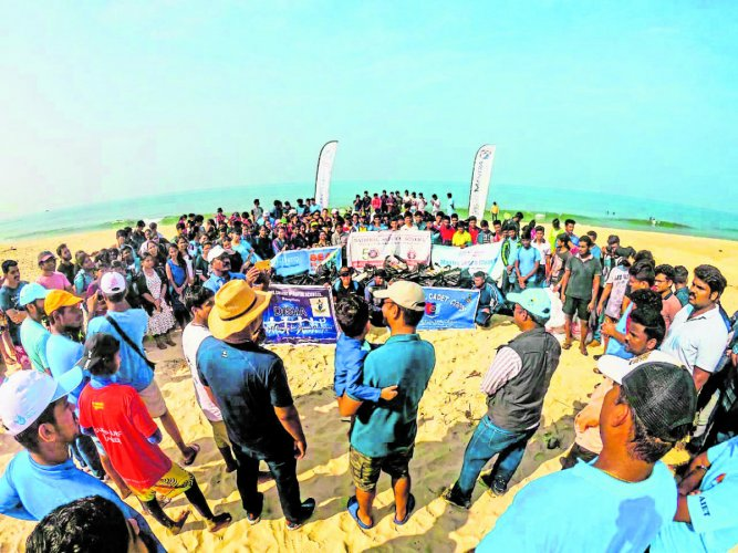 Volunteers take part in beach cleanliness drive at Kolachikambala in Mulki on Sunday.