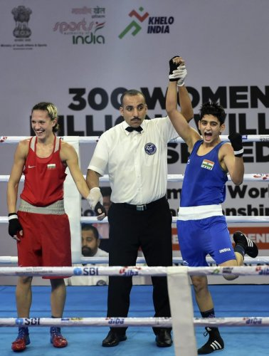 India's Sonia Chahal is declared winner against Bulgarian Stanimira Petrova (left) in the women's light flyweight 57 kg category of the AIBA Women's World Boxing Championships in New Delhi on Monday.
