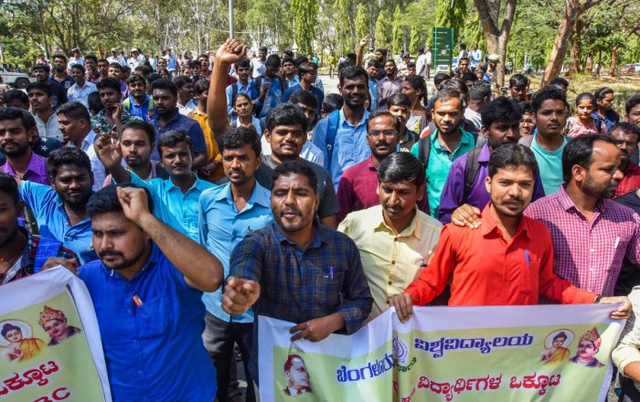 Thousands of BU students and faculty members on Tuesday protested against the KPSC decision to stop SC/ST/OBC candidates to get recruited under the general merit quota.